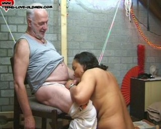 old man with young girl in the basement